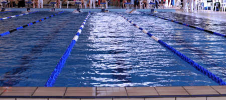 playoff: A new lap for teens during playoff in a indoor swimming pool