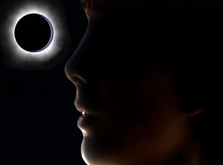 surpass: Abstract: Boy close profile backlighting an eclipse Stock Photo