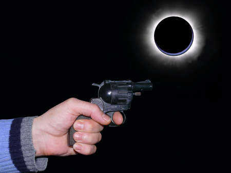 Abstract: armed hand guy during an eclipse   photo