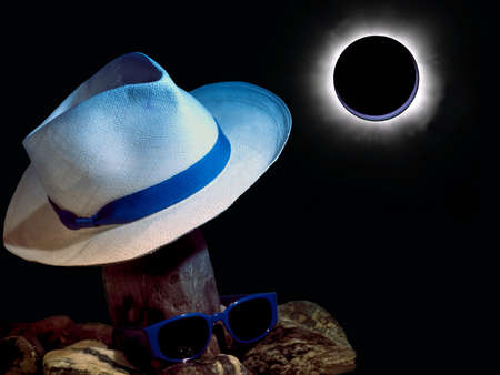 Abstract: boater sunglasses and cobblestones backlighting an eclipse photo