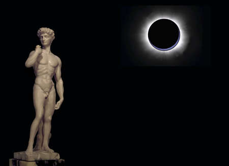 Abstract: David of Michelangelo statue backlighting an eclipse photo