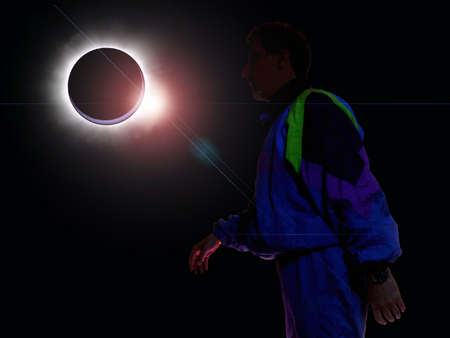 backlighting: Abstract: guy silhouette backlighting an eclipse