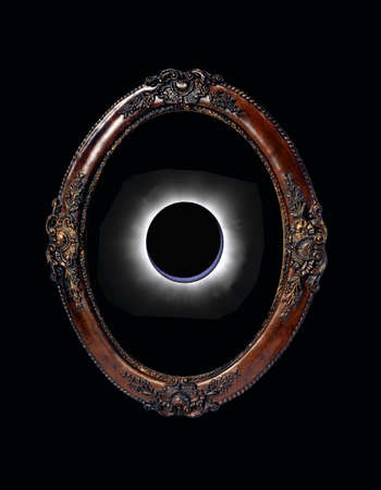 Abstract: Eclipse showed by an empty wood Frame  photo