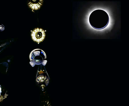 Abstract: Eclipse and hanging old lamps  photo