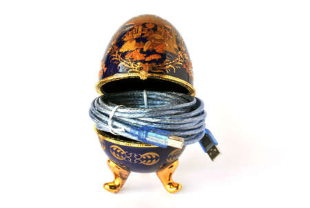 serial: Easter Egg (Faberge Eggs) with USB cable in isolated on white