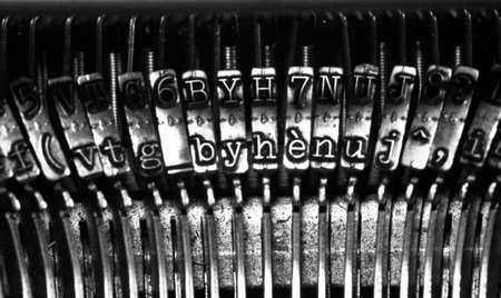 Detail of some old dusty typewriters, monochromatic photo photo