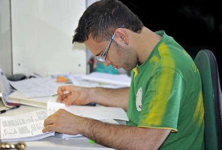Handsome undergraduate studying Stock Photo - 5022562