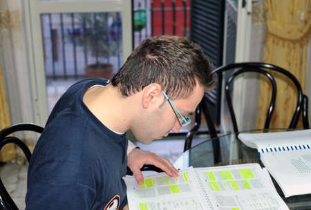 Young man studying at home Stock Photo - 5069775