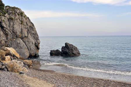 headland: Rocky coast waterfront with horizon in background Stock Photo