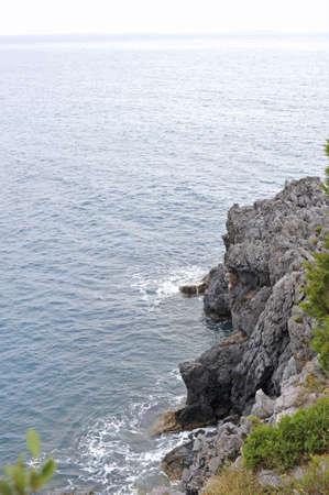 limpid: Sheer and rocky coastline, Cilento, Italy Stock Photo