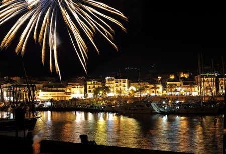 Holiday fireworks over sea by night, Marina of Camerota, Italy Stock Photo - 5423025