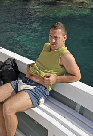 Young man having a rest on a boat during a ride Stock Photo - 5444120