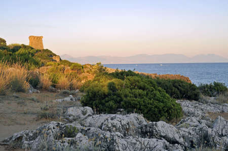 Panoramic view by rocky coastline at the sunset, Palinuro, Italy photo