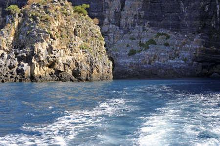palinuro: Motorboat foamy wake along Palinuro seacoast, Italy Stock Photo