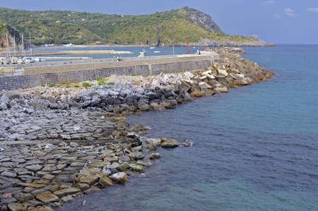 bulwark: Observation platform along bulwark hemming harbor, Camerota, Italy  Stock Photo