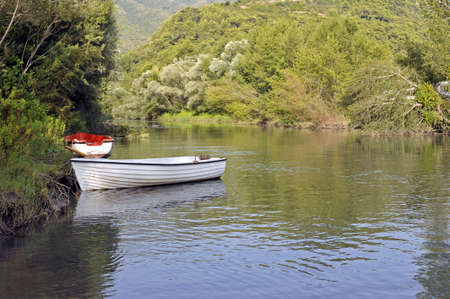 Relaxing view of a river shore with moored boats Stock Photo - 5646123