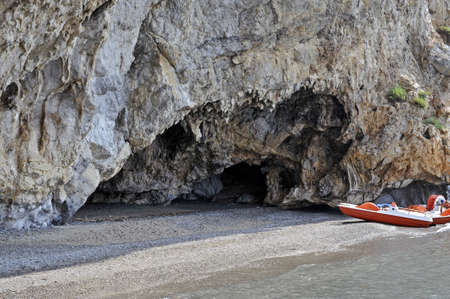 palinuro: Detail of a secluded beach under a cavernous rock, Palinuro coast, Italy