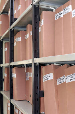 Work site with and old archive with folders on metal shelf Stock Photo - 5646142