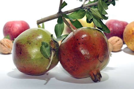 halved  half: Autumn time: fruits with two fresh Pomegranates in foreground