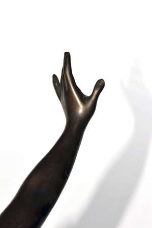 hand carved: Bronze statue: detail of a female stretched out arm