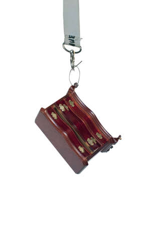 Abstract: a furniture hanging on a snap-hook, studio shot Stock Photo - 5751835