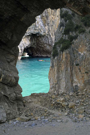 dive trip: Rock and ocean foreshortening view through a cave, Palinuro, Italy