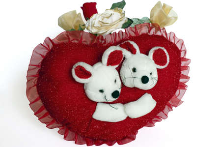 Valentine red heart-shaped pillow sham with teddy bears and artificial roses Stock Photo - 5821988