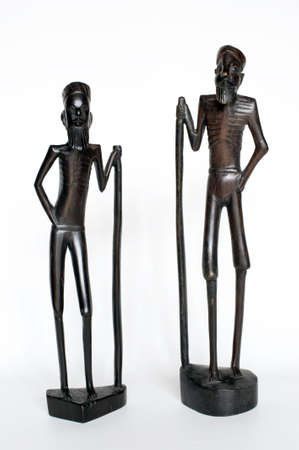 Two very old African wood figure isolated on white Stock Photo - 5821994