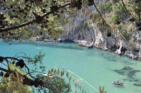 vacationer: Turquoise seawater along characteristic Palinuro coast, Italy Stock Photo
