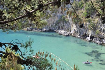 palinuro: Turquoise seawater along characteristic Palinuro coast, Italy Stock Photo