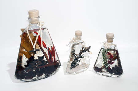 Three decorative bottles of aromatic oil (or liquid wax) photo