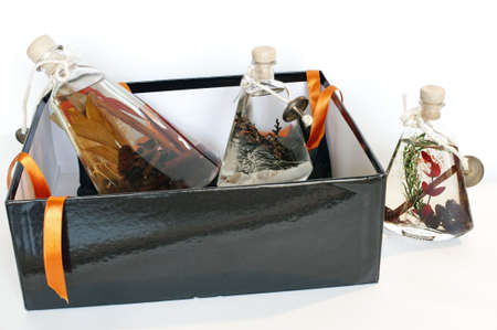Gift-box with decorative bottles of aromatic oil  Stock Photo - 5896104