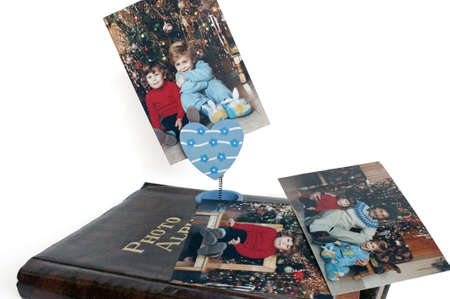 Photo album with flowerpot-holder gripping a Christmas photograph photo