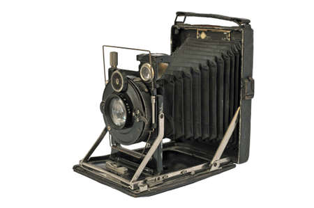 oldie: Ancient photographic camera with lens of bellows over white Stock Photo