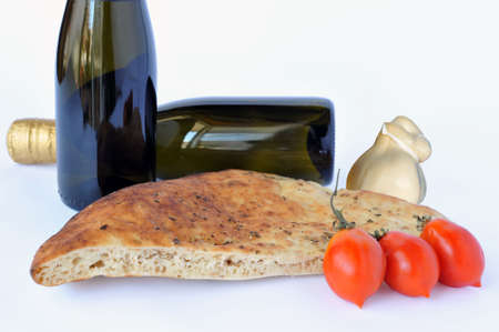 provola: Wine bottles, piece of pizza with tomatoes and cheese on white Stock Photo