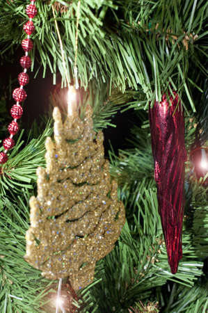 Festive decorations hanging on the Christmas tree Stock Photo - 6063734