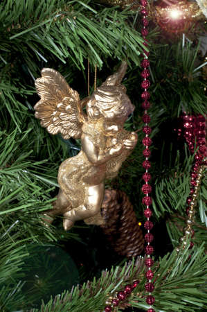 Decorative golden angel hanging on the Christmas tree Stock Photo - 6063740
