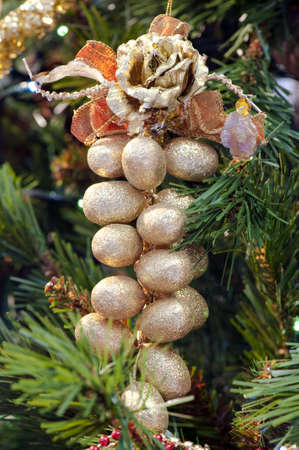 Detail of a golden decorative bunch of grapes hanging on the Christmas tree Stock Photo - 6063649
