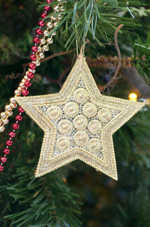 Close-up of a golden decorative star hanging on the Christmas tree Stock Photo - 6063743