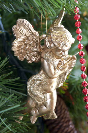 Close-up of a decorative golden angel on the Christmas tree Stock Photo - 6063762