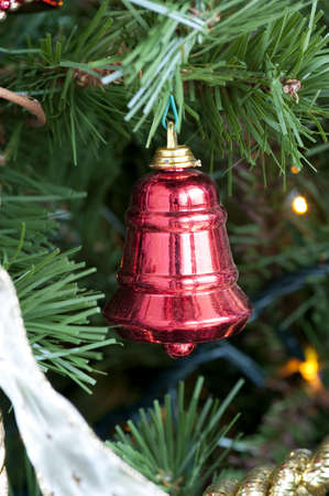 Detail of a decorative red bell on the Christmas tree Stock Photo - 6063731