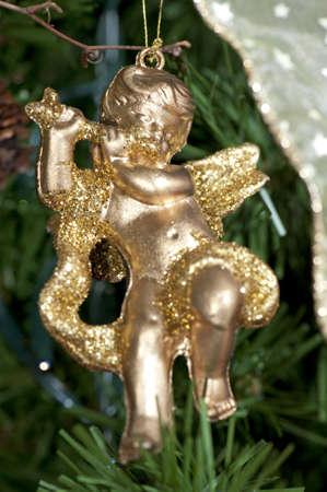 Close-up of a decorative golden angel on the Christmas tree Stock Photo - 6063657