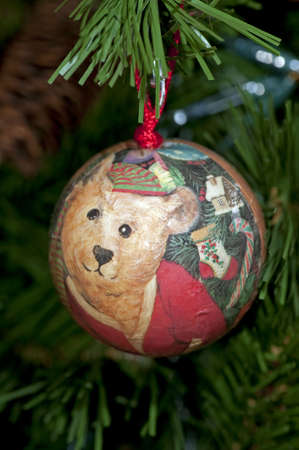 Detail of an old wooden ball hanging on the Christmas tree Stock Photo - 6063658