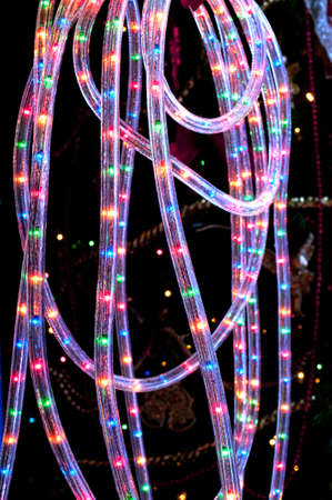 switched: Detail of a flexible tube rope with colored LED switched on in the dark