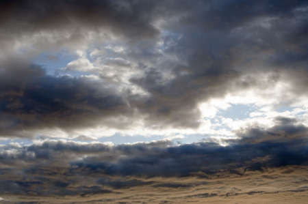 Violent formation of dramatic storm clouds against a dark blue sky