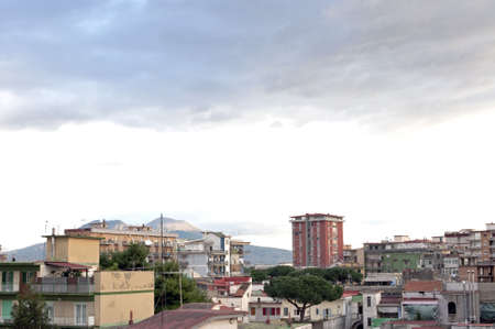 periphery: Landscape with sky and buildings in front of Vesuvius, Naples outskirts, Italy   Stock Photo