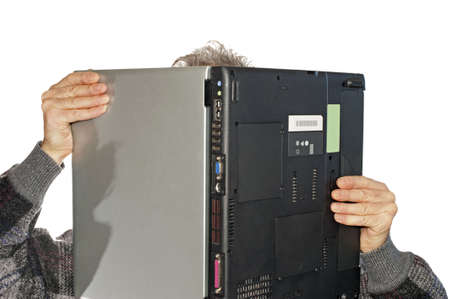 Abstract: man holding and looking at a laptop as a newspaper in horizontal photo