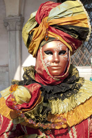 Carnival in Venice, a girl with mask photo