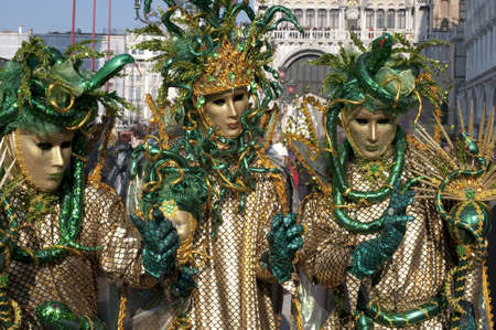 Three dressed up women on the Markuss square for the Carnival in Venice  photo