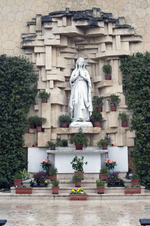 of our lady: Our Lady of Lourdes statue in the church of San Leonardo hill at Verona, Italy